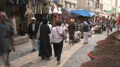 People walk through old city of Sanaa in Yemen Stock Footage