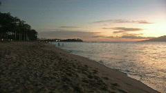 Sunset on beach pan rt M HD Stock Footage