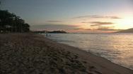 Stock Video Footage of Sunset on beach pan rt M HD