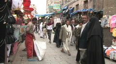 People walk through the old city of Sanaa Stock Footage