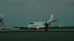 Private jet taxiis through frame Stock Footage