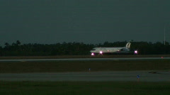 Cargo jet in background at dusk - stock footage