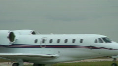 Corporate jet rolls through frame Stock Footage