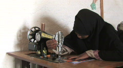 Yemen: girls learn sewing skills - stock footage