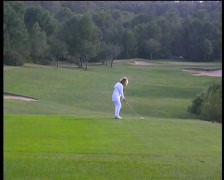 Stock Video Footage of Golf woman in white teeing off