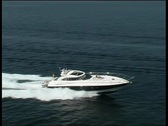 Stock Video Footage of Blue motoryacht at sea 1