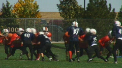 Kids play American football Stock Footage