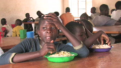 Disabled girl eats meal at the Nyaburi center for the disabled in Kenya Stock Footage