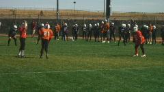 Boys play American football Stock Footage