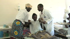 Woman with AIDS recieves antiretroviral therapy at a AIDS ward in Africa Stock Footage