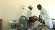 Stock Video Footage of Woman with AIDS recieves antiretroviral therapy at a AIDS ward in Africa