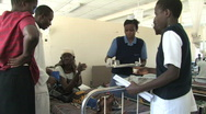 Stock Video Footage of Woman with AIDS receives antiretroviral therapy in a AIDS ward in Africa