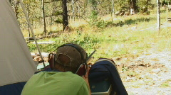 Young man fires vintage 22 caliber rifle Stock Footage