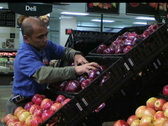Stock Video Footage of Man Facing Apples In Produce