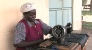 Woman works at a sewing machine in Kenya, Africa Stock Footage