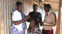 Woman gets hair extentions in Kenya, Africa Stock Footage
