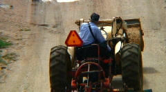 Man on tractor performs road maintenance Stock Footage