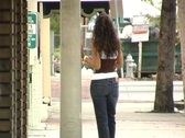 Stock Video Footage of Beautiful Latina Walking on a Downtown Sidewalk