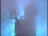 Stock Video Footage of Film projector in smoke
