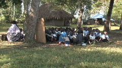 Young students have class outside in a school in Kenya Africa Stock Footage