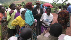 People wait in line for a food distribution in Rwanda - stock footage