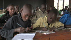 Students in class take notes in a school in Rwanda, Africa - stock footage
