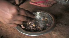 Girls eat a simple meal of beans in their home in Tanzania - stock footage