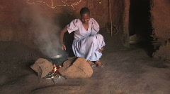 Girl Cooks Over Fire  - stock footage