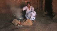 Girl Cooks Over Fire  Stock Footage