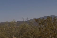 High voltage power pole zoom out Stock Footage