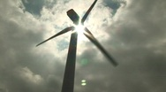 Stock Video Footage of Wind turbine with sun