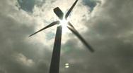 Wind turbine with sun Stock Footage