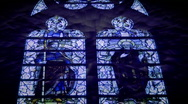 Stock Video Footage of Light rays shining through stained glass windows that change color. HD 1080i