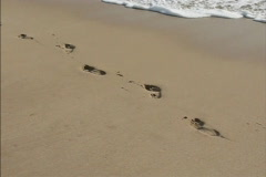 Footprints in the sand  Stock Footage