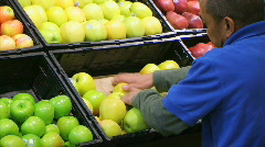 Man Facing Apples In Produce 02 - stock footage