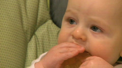Infant Male  with plastic toy in mouth (6 month old) Stock Footage