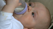 Stock Video Footage of Infant Male (6 month old) with bottle (3 of 3)
