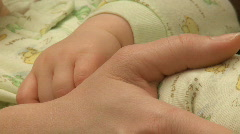 Infant hand with mothers hand (6 month old) Stock Footage