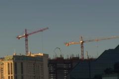 Skyscrape cranes in action Stock Footage