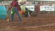 Rodeo bull mad after ride attacks clown M HD Stock Footage
