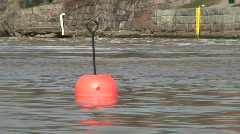 Red buoy in a river Stock Footage