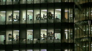 Stock Video Footage of Brightly lit glass fronted office block at City Hall at night London England