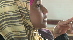 Close-up of young girl in class in a school in Yemen - stock footage