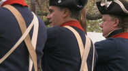 Stock Video Footage of Revolutionary War Soldiers at Backs at Attention