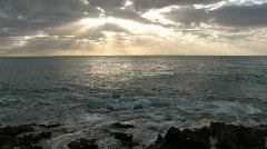 Hawaiian sunset rays rocks ocean Hawaii M HD Stock Footage