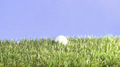 Approaching golfball Stock Footage