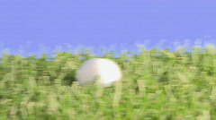 Approaching golfball close Stock Footage