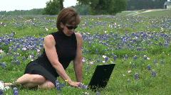 Woman laptop bluebonnets part 2 Stock Footage