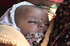 Nepal:  Mother and baby wait to see the Doctor - stock footage