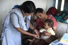 Nepal: Baby gets checked by doctor - stock footage